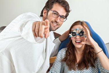 Optometrist Giving Woman Eye Examination