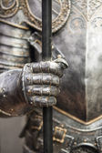Detail of a medieval knight armor with sword