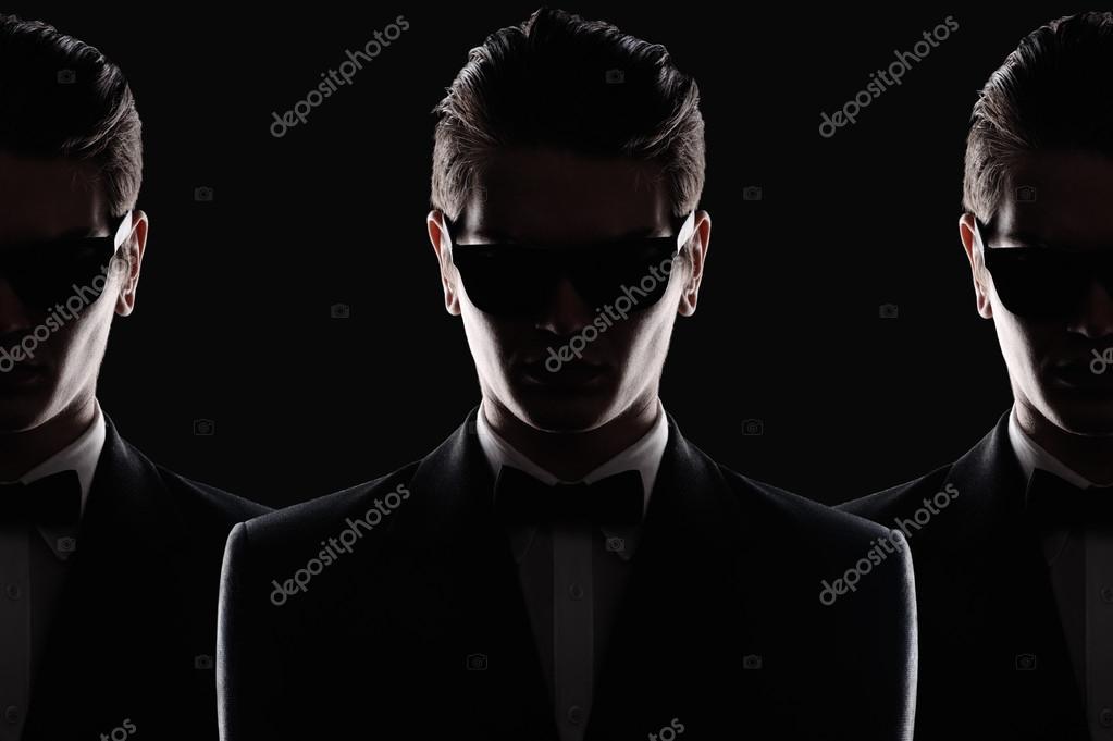 Силуети юнак носити сонцезахисні окуляри в темній кімнаті — Фото від  alex supertramp 4b63a357758f4