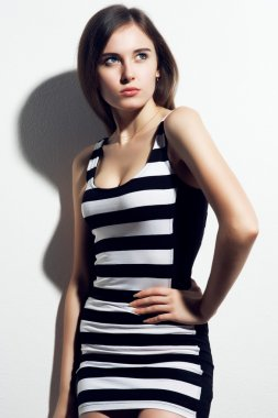 Fashionable woman in striped dress