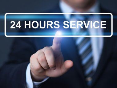 Businessman pressing button with 24 hours service on virtual screen