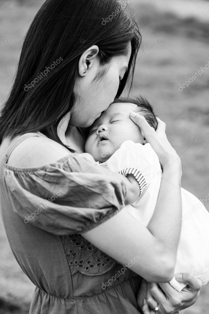 Cute Black Asian Babies Black And White Asian Mother Kissing The Cute Baby Stock Photo C Todsapornw 36691541