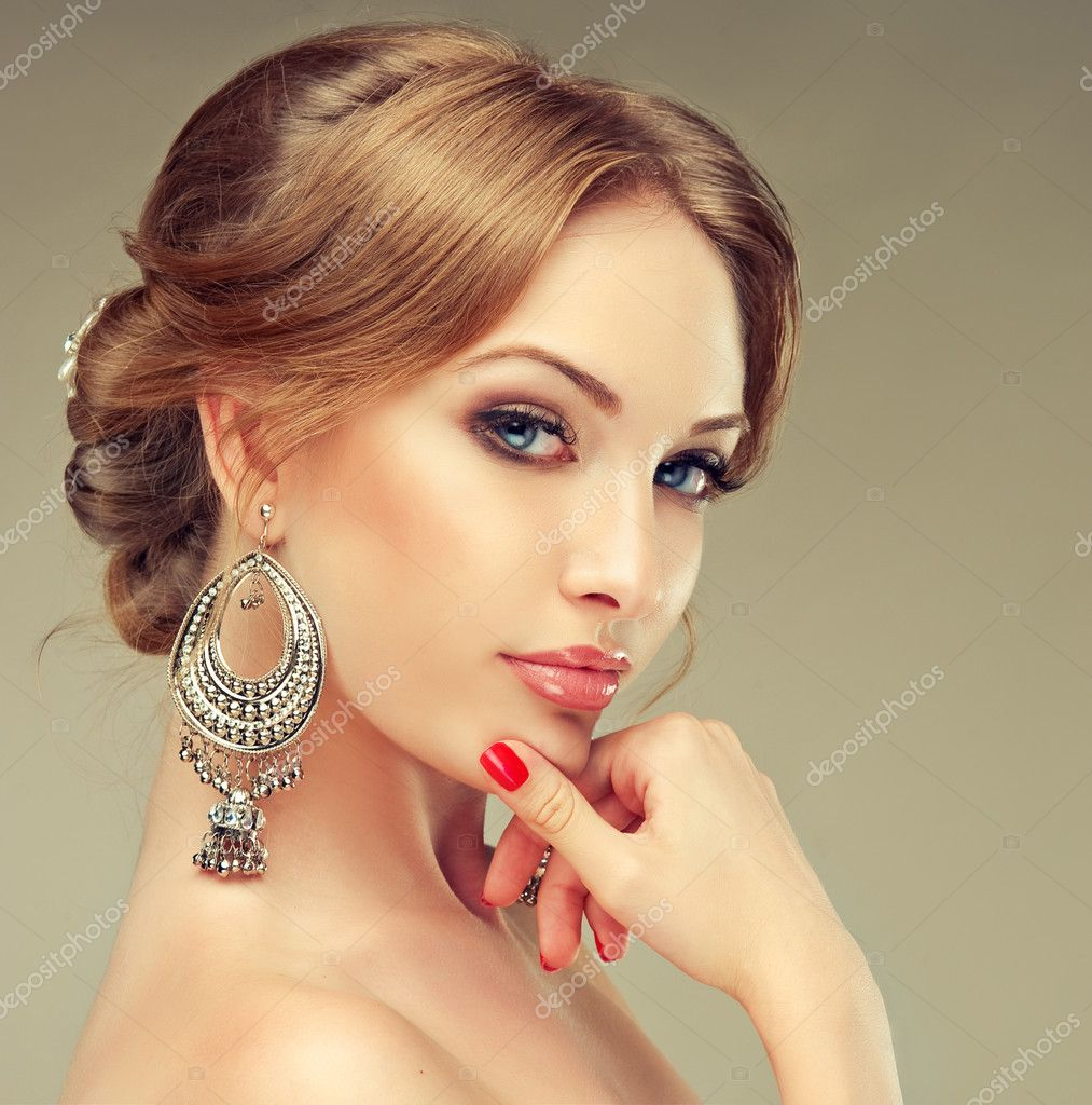 image picture woman putting earrings images on getty photo free royalty stock detail