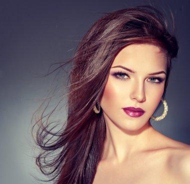 Beautiful brunette wearing earrings