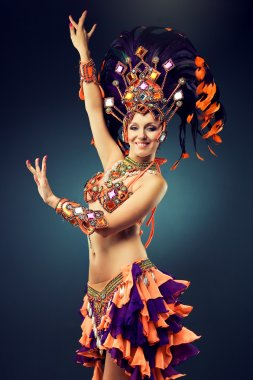 Belly dancer in colorful carnival dress