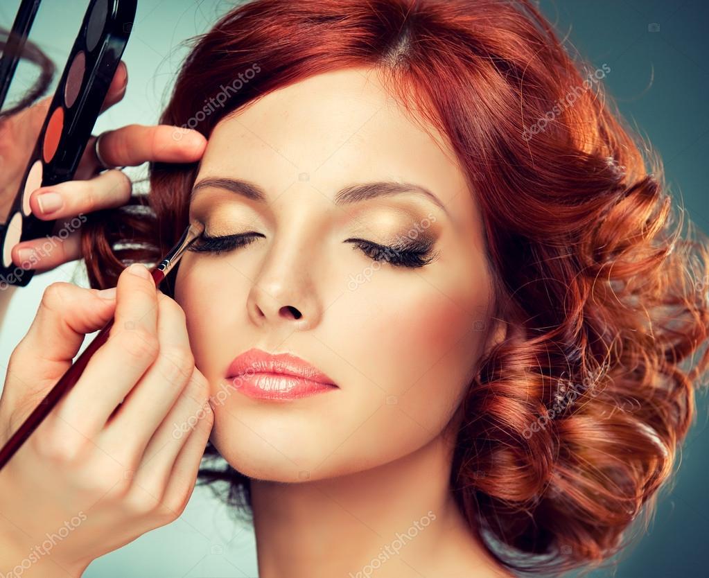 Artist doing glamour model makeup