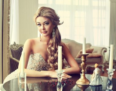 Girl in evening dress sitting at a table