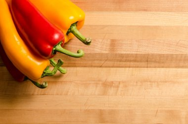 Fresh peppers on chopping board