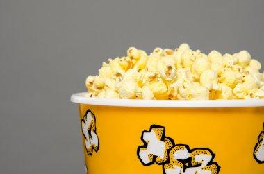 Closeup of large bucket of popcorn