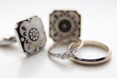 Silver cufflinks with wedding rings