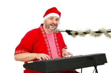 Man in Santa Claus suit singing a song