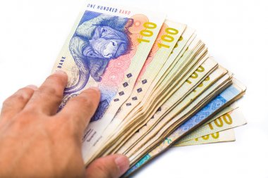 south african man holding new bank notes isolate on white