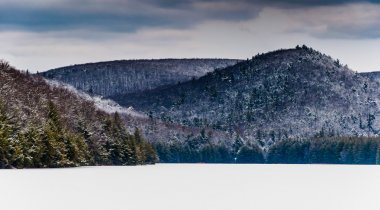 Snow and ice covered mountains surrounding Long Pine Run Reservo