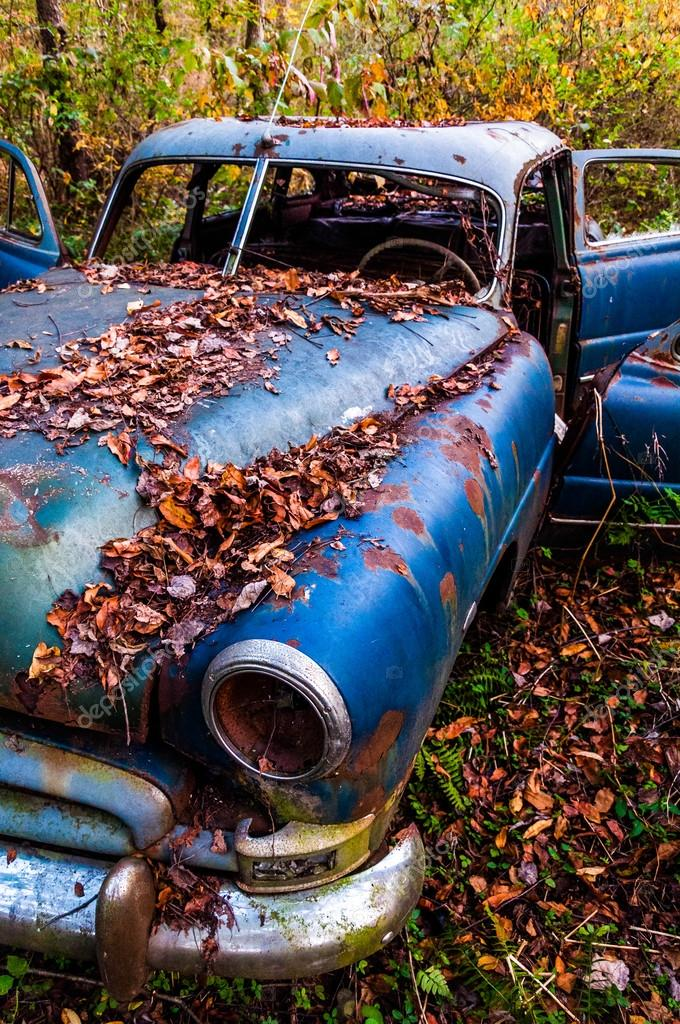 A Rusty Abandoned Car In The Woods Stock Editorial Photo