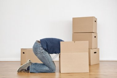 Woman Unpacking Boxes in New Home