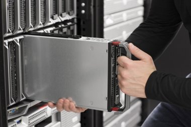 IT Engineer insert a Blade Server in Data Center