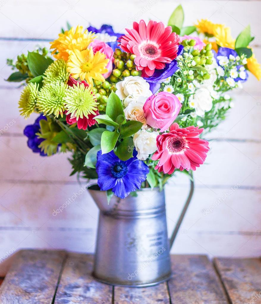 Colorful Bouquet Of Spring Flowers In Vintage Vase On Rustic Wooden