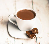 Photo Cup of hot chocolate on wooden background