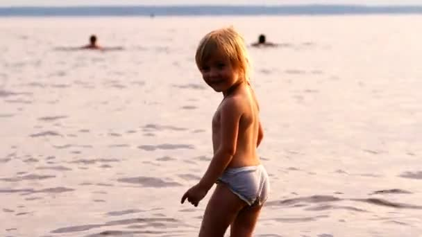 Little girl laps in water, is going to bathe