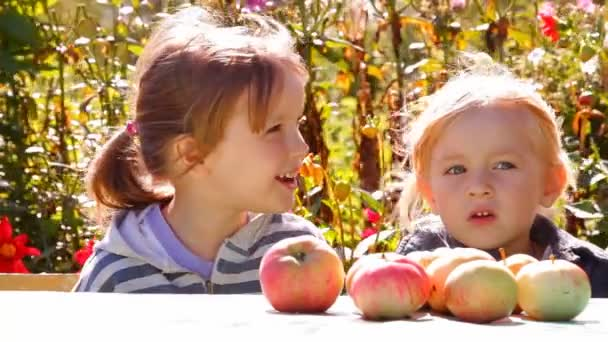 Two girls with apples, eat talk