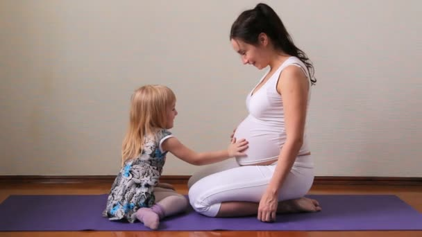 A pregnant woman with a child communicate