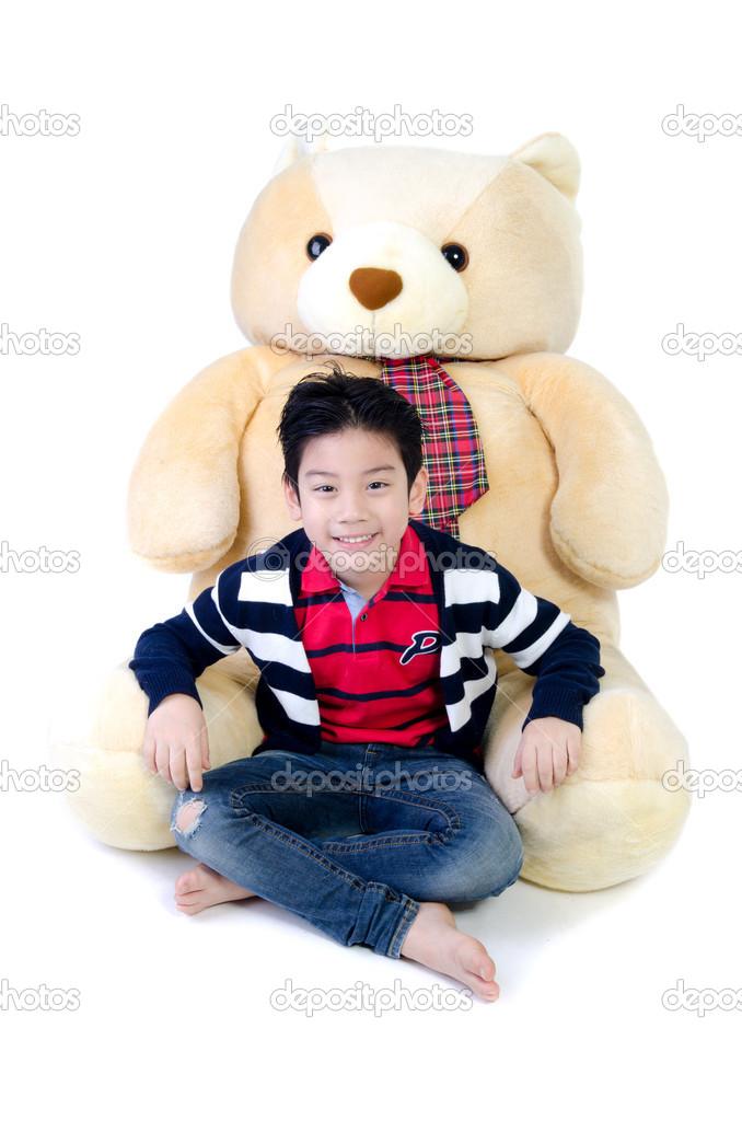 Asian boy with big bear doll stock photo sirikornt 38125653 asian boy with big bear doll publicscrutiny Choice Image