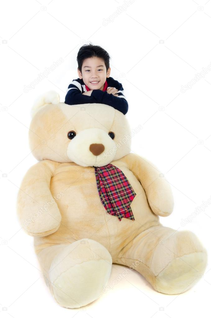 Asian boy with big bear doll on white background stock photo asian boy with big bear doll on white background photo by sirikornt publicscrutiny Choice Image