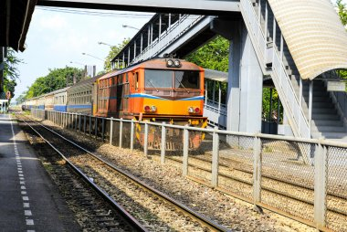 Red orange train, Diesel locomotive, on Bangkok railway station