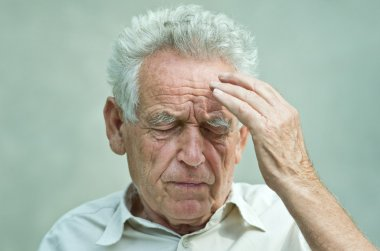 Old man with headache