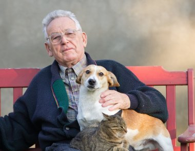 Old man with dog and cat