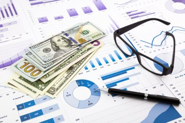 Dollar currency on graphs, financial planning and expense report