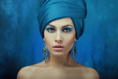 Eastern stylish girl with a turban on his head