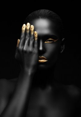 woman with golden make-up.