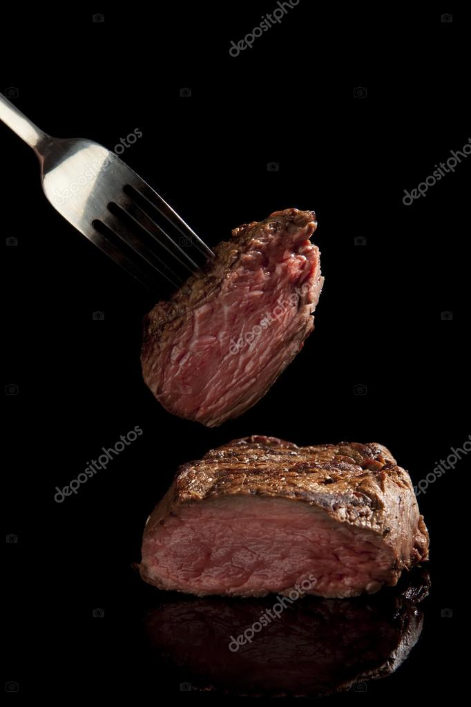 juicy steak with fork
