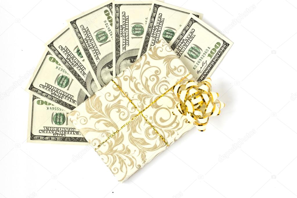 hundred dollar bills on a white background gift wrap stock photo
