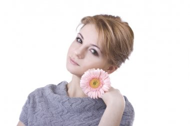 Beautiful girl with a big flower in hand on white background