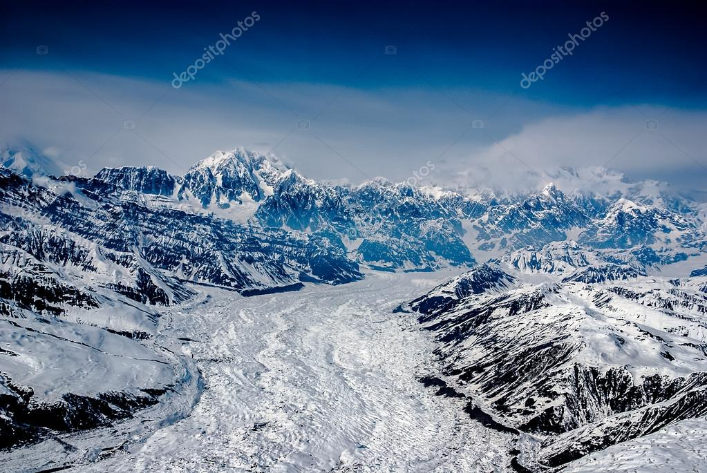Aerial View of a Craggy Snow Covered Alaskan Mountain Range