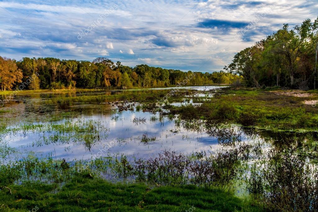 Beautiful Mesmerizing Reflections of Amazing Clouds on Colorful Creekfield Lake, Texas.