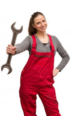 Young female worker with wrench
