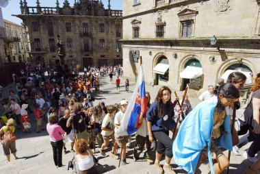 Catholic pilgrims come up to St. James Cathedral on Saint James Day in Santiago, Spain.