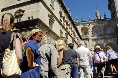 Catholic pilgrims wait their turn for visiting St. James Cathedral on Saint James Day in Santiago, Spain.