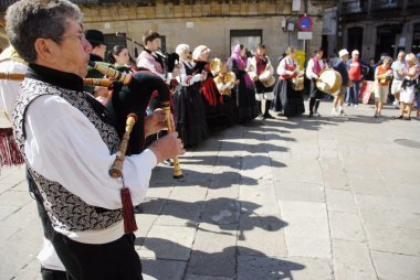 Galician musicians play their gaita (galician bagpipe) in honor of Saint James Day in Santiago, Spain.