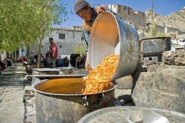 Volunteer cooks public tukpa (soup) at a puja ceremony in Leh, Ladakh, India.