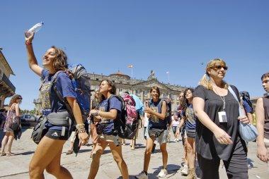 Young Catholic pilgrims on Saint James Day in Santiago de Compostela, Spain.