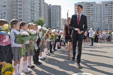 Senior students welcome first-formers on traditional ceremony on September 1 in Russia.