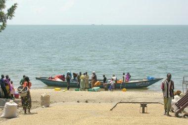 Rwandan people wait for a new fish catch on Lake Kivu shore in Gisenyi, Rwanda.