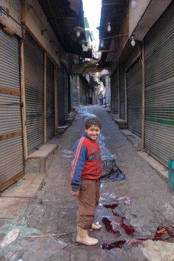 Egyptian boy on a street after celebration Kurban Bayram in Cairo, Egypt.