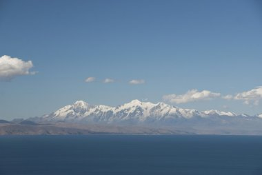 View of Andes Mountain Range over Lake Titicaca, Bolivia.