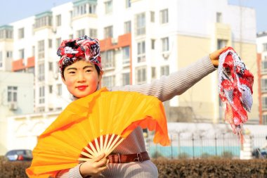 people wear colorful clothes, yangko dance performances in the s