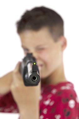 Boy targeting with airgun
